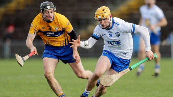 Waterford's Peter Hogan and Jack Browne of Clare compete for possession