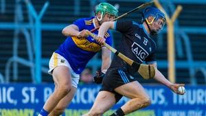 Dublin's Oisin O'Rorke (R) is pursued by James Barry