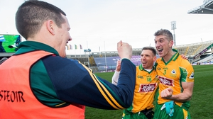 Corofin's Kieran Fitzgerald (R) celebrates with manager Kevin O'Brien (L) and Ciaran McGrath