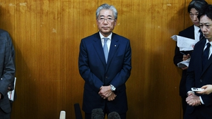 Tsunekazu Takeda speaks to the media in Tokyo today