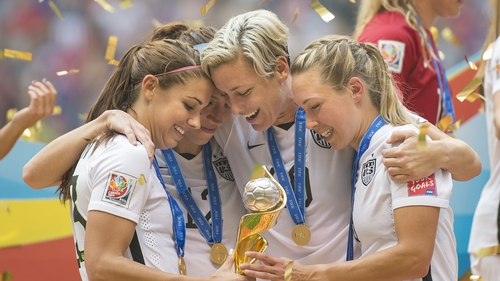 USA players celebrate after winning the 2015 world cup