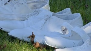 Shoes were donated by members of the public and painted white by a church volunteer.
