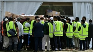 Mourners carry the coffins of Khalid Mustafa and his son Hamza Mustafa