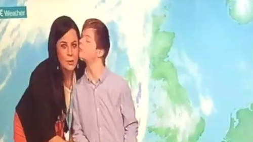 Cameron McNamara plants a kiss on the unsuspecting Audrey McGrath on the RTÉ Weather set