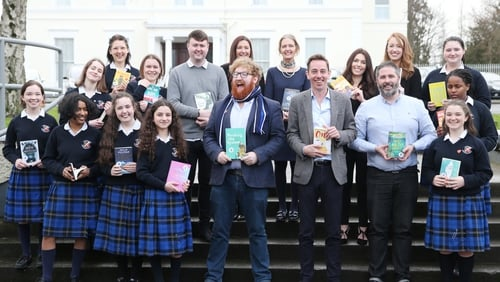 Author Dave Rudden and Ryan Tubridy with pupils and staff from St Raphaela's Secondary School Dublin, launching Children's Books Ireland's library campaign