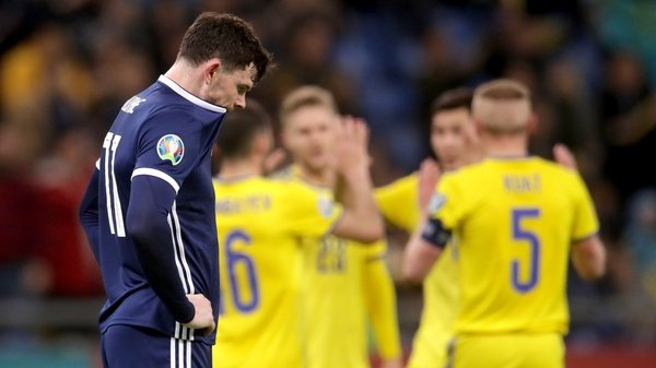 Oliver Burke cuts a forlorn figure after the concession of another goal against Kazakshtan