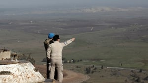 UN personnel survey the Israel-Syria border