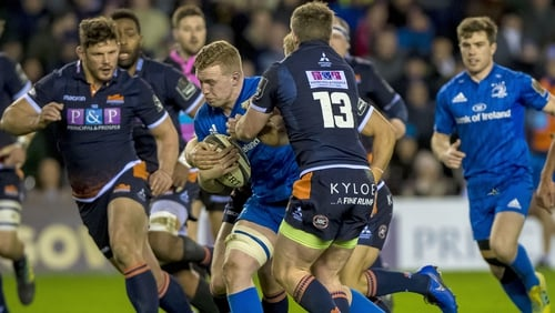 Leinster's Dan Leavy is tackled by James Johnstone