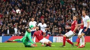 Raheem Sterling scores England's third