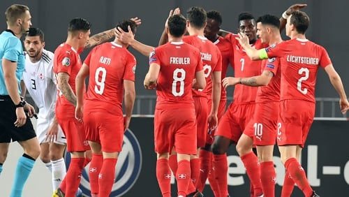 Switzerland's players celebrate their second goal