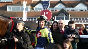 oel Fehily poses with his family after winning his last race before retirement
