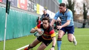 Lansdowne's Dan McEvoy scores a try against UCD