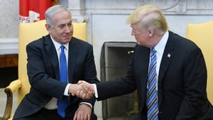 Donald Trump signed the document at the start of a meeting with Benjamin Netanyahu