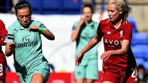 Kirsty Linnett of Liverpool is tracked by Katie McCabe
