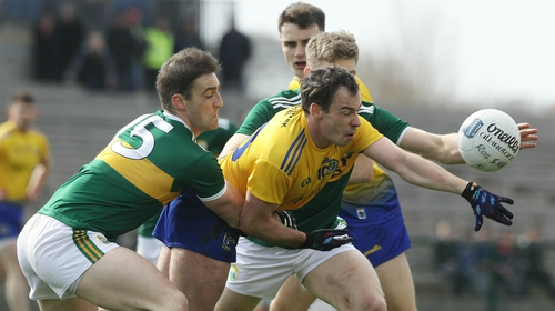 Roscommon's Niall Kilroy tackled by Stephen O'Brien and Peter Crowley