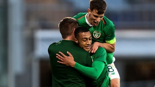 Adam Idah celebrates scoring a goal with Ireland manager Stephen Kenny and Jayson Molumby