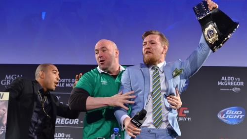 Dana White (C) and Conor 'McGregor (R) at the press conference for McGregor's fight against Jose Aldo (L) in 2015