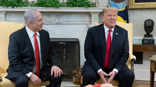 Donald Trump signed the order during visit by Benjamin Netanyahu