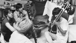 The Beatles with George Harrison on sitar, watched by Lennon and McCartney and teacher