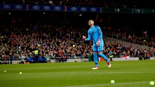 Darren Randolph clears the pitch of tennis balls