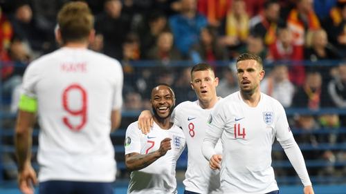 Harry Kane celebrates Raheem Sterling's goal on Monday night