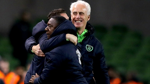 Mick McCarthy celebrates Conor Hourihane's goal with Robbie Keane and Terry Connor