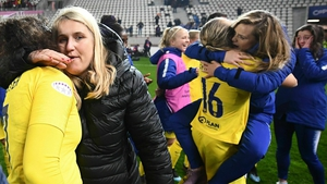 Chelsea's head coach Emma Hayes (2nd L) and her players celebrate