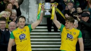Michael Murphy and Hugh McFadden lift the trophy