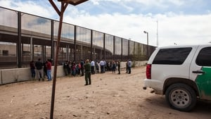 Migrants from Central America held at a border crossing in El Paso