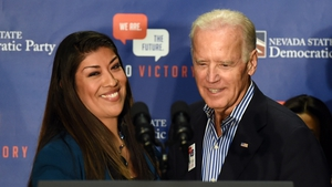 Lucy Flores with Joe Biden at a rally