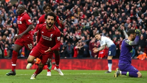 Mohamed Salah wheels away in celebration after Liverpool's dramatic winner