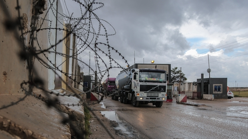Trucks carrying food and fuel rolled into Gaza through the reopened Kerem Shalom crossing