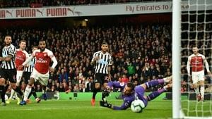 Aaron Ramsey steers home the opener for Arsenal