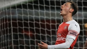 Mesut Ozil claims he's staying with Arsenal