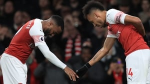 Alexandre Lacazette (L) celebrates his game-clinching goal with Pierre-Emerick Aubameyang