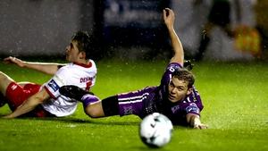 Georgie Kelly of Dundalk has eyes on the ball after tangling with Lee Desmond of St Pat's