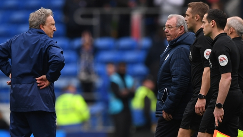 Cardiff manager Neil Warnock (L) was not happy with Craig Pawson and the officials