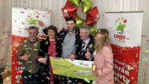 Odhrán Doherty accepting his winnings at National Lottery headquarters in Dublin