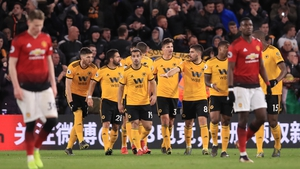 Man United players Scott McTominay, left, and Paul Pogba, react to Wolves' second goal at Molineux Stadium