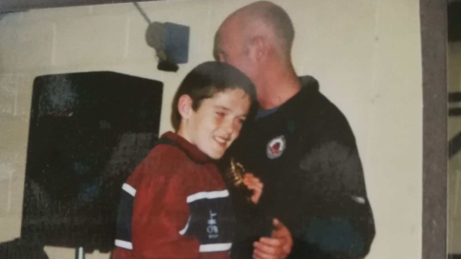 Image - Fenton receives his U12 winner's medal from Dr Noel McCaffrey, Jack's father