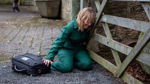 Rhona collapses at the stables