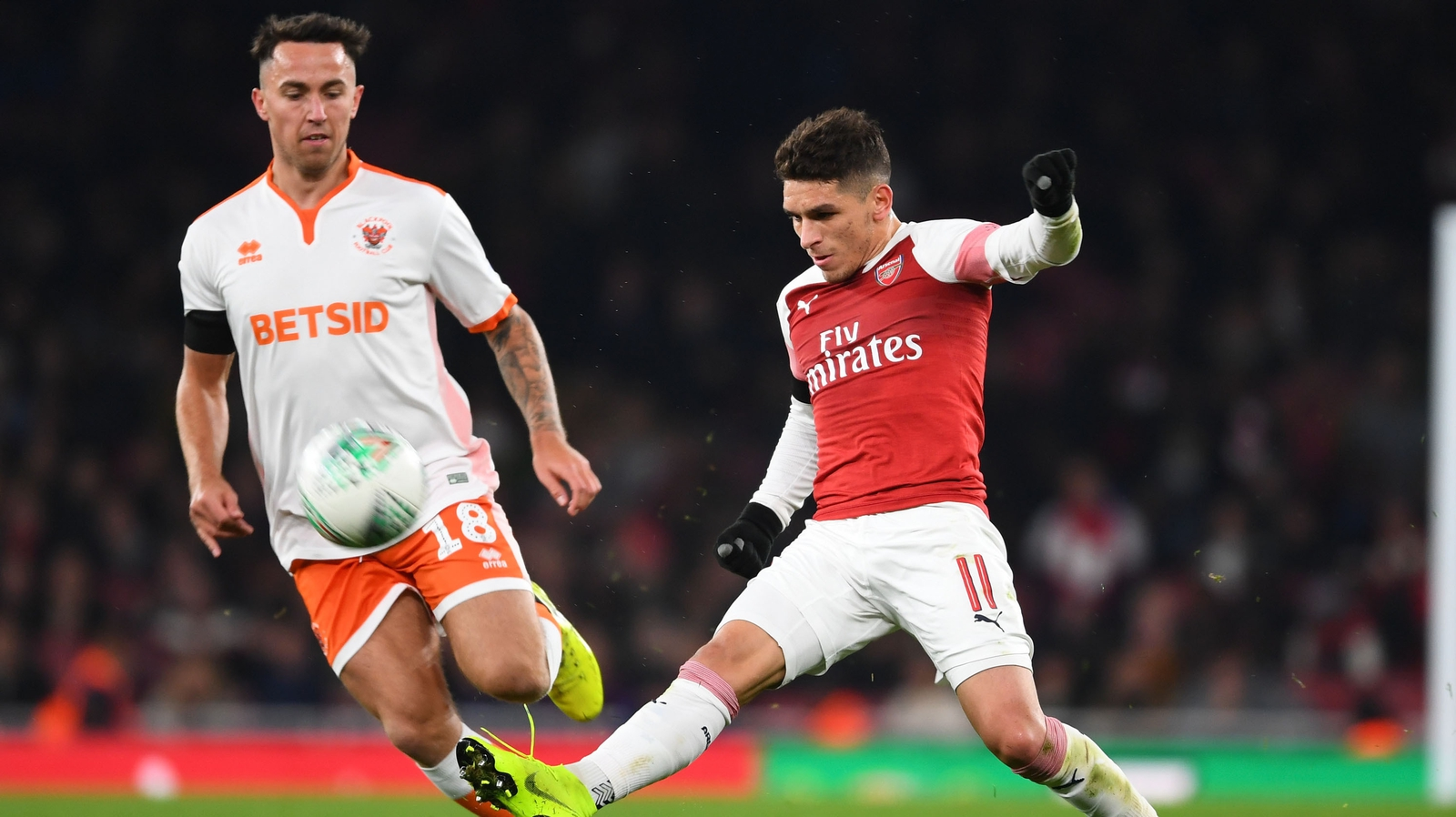 Image - Arsenal's Lucas Torreira fends off John O'Sullivan in the Carabao Cup last year