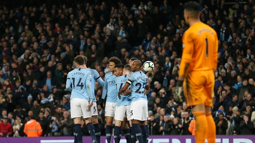 City players congratulate Leroy Sane after his goal against Cardiff