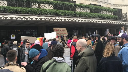 Several hundred people gathered outside the hotel calling for homophobia to be stamped out