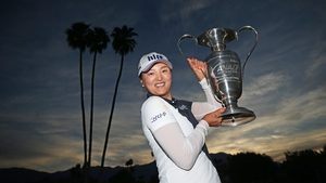 Jin Young Ko poses with the Dinah Shore Trophy