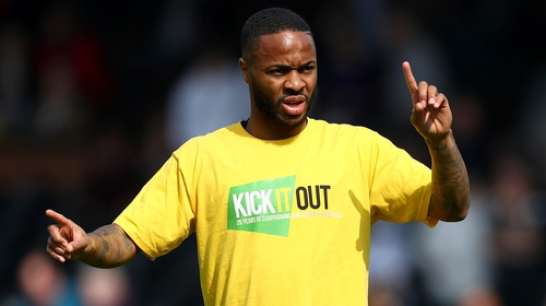 Manchester City's Raheem Sterling wears a Kick It Out anti-racism shirt