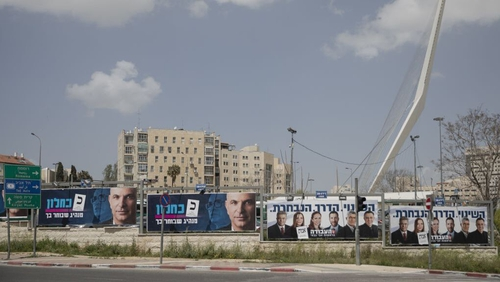 Posters of candidates are seen in Jerusalem prior to today's early general elections