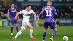 James McClean scored in the 3-1 defeat away to Swansea City