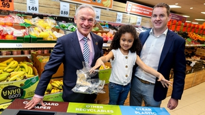 Amelia-Lily Nwanguma, from Rialto in Dublin gives Minister Richard Bruton and JP Scally, Managing Director, Lidl Ireland, a helping hand to launch Lidl's new in-store recycling stations