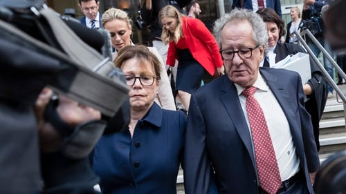 Geoffrey Rush and his wife Jane Menelaus pictured leaving the Supreme Court of New South Wales